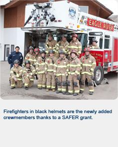 Firefighters in black helmets are the newly added crewmembers thanks to a SAFER grant.