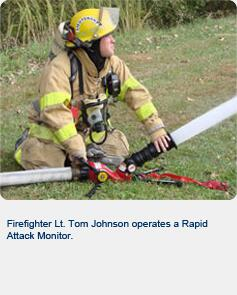 Firefighter Lt. Tom Johnson operates a Rapid Attack Monitor.