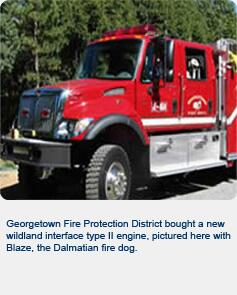 Georgetown Fire Protection District bought a new wildland interface type II engine, pictured here with Blaze, the Dalmation fire dog.