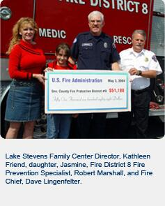 Lake Stevens Family Center Director, Kathleen Friend, daughter, Jasmine, Fire District 8 Fire Prevention Specialist, Robert Marshall, and Fire Chief, Dave Lingenfelter