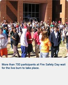More than 700 participants at Fire Safety Day wait for the live burn to take place.