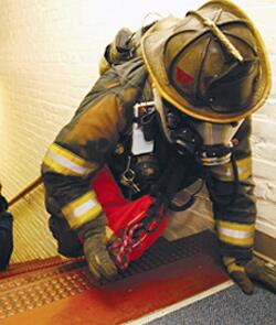 Firefighter exercises - crawling up stairs to look for lost collegue