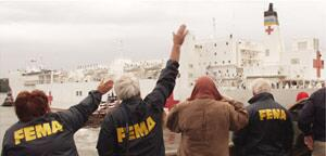 FEMA employees wave goodbye to the USNS Comfort as she left Manhattan October 1, 2001