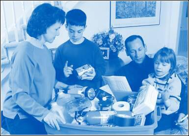 Image of family gathering food supplies for disaster supplies kit