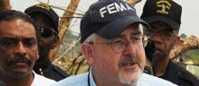FEMA Administrator Craig Fugate answers questions at a press conference in tornado damaged Pratt City, AL.