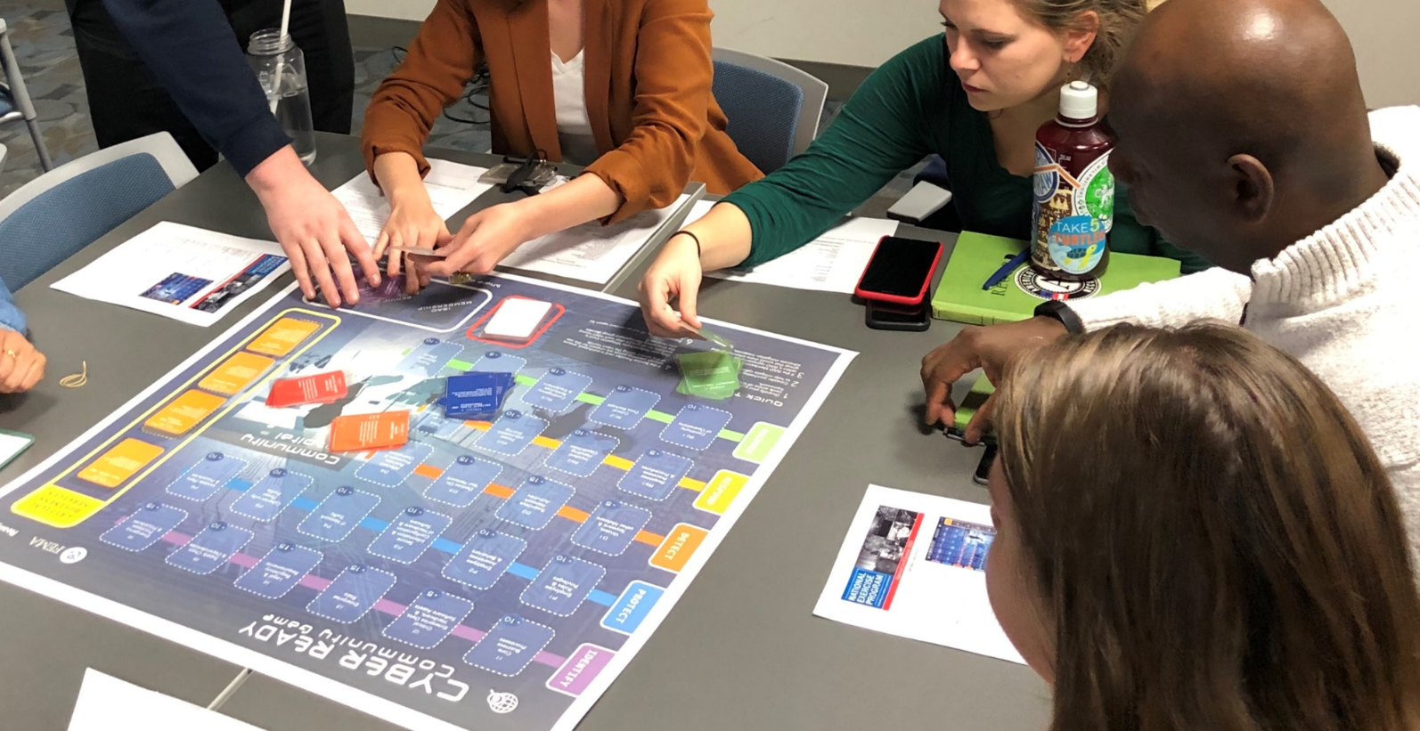 People playing the Cyber Ready Community board game
