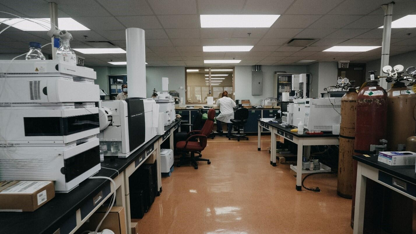 A lab with multiple machines with one person in the the lab
