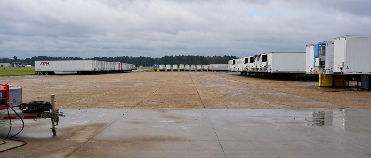 A wide view of a large outdoor lot with numerous trailers