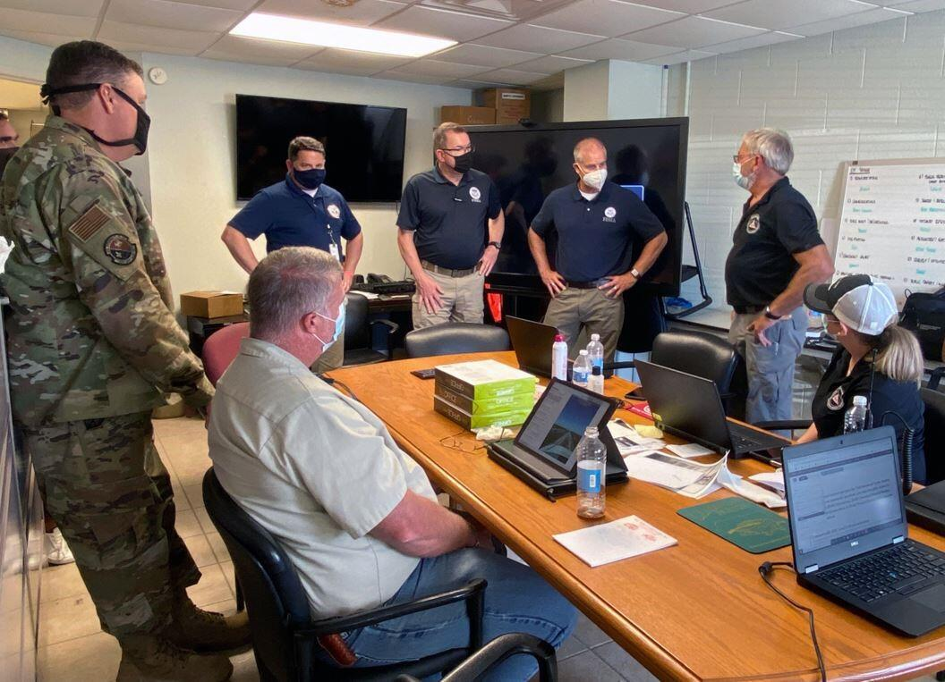 FEMA Administrator Pete Gaynor (standing, 2nd from left) and FEMA's Region 6 Administrator Tony Robinson (standing, 3rd from left) visits Cameron Parish Office of Homeland Security and Emergency Management to discuss the impact of Hurricane Delta and FEMA's continued effort to support the area.