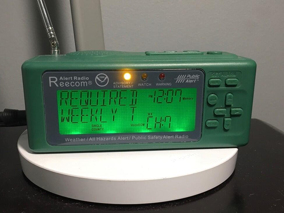 A green NOAA Weather Radio